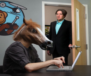 wearing horsehead mask at the office