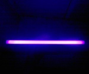 Glowing black light tube fixture