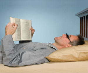 man reading with prism glasses
